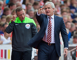 STOKE-ON-TRENT, ENGLAND - Sunday, August 9, 2015: Stoke City's manager Mark Hughes protests to the assistant referee during the Premier League match against Liverpool at the Britannia Stadium. (Pic by David Rawcliffe/Propaganda)