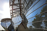 Glass 'sails' of the Fondation Louis Vuitton, an art museum and cultural centre designed by Frank Gehry, b. 1929, and built 2008-14, next to the Jardin d'Acclimatation in the Bois de Boulogne, in the 16th arrondissement of Paris, France. The building resembles the sails of a boat and houses 11 galleries, an auditorium seating 350 and roof terraces. Picture by Manuel Cohen