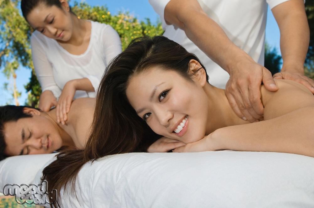 Couple having massage at health spa, close-up