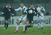 (L) Lechia's Pawel Buzala and (R) Polonia's Aleksandar Todorovski fight for the ball during T-Mobile Extraleague soccer match between Polonia Warsaw and Lechia Gdansk in Warsaw, Poland...Poland, Warsaw, February 22, 2013...Picture also available in RAW (NEF) or TIFF format on special request...For editorial use only. Any commercial or promotional use requires permission...Photo by © Adam Nurkiewicz / Mediasport