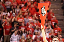 17 January 2015:   A male Cheerleader holds up his megaphone as he takes the court for a routine during an NCAA MVC (Missouri Valley Conference men's basketball game between the Bradley Braves and the Illinois State Redbirds at Redbird Arena in Normal Illinois