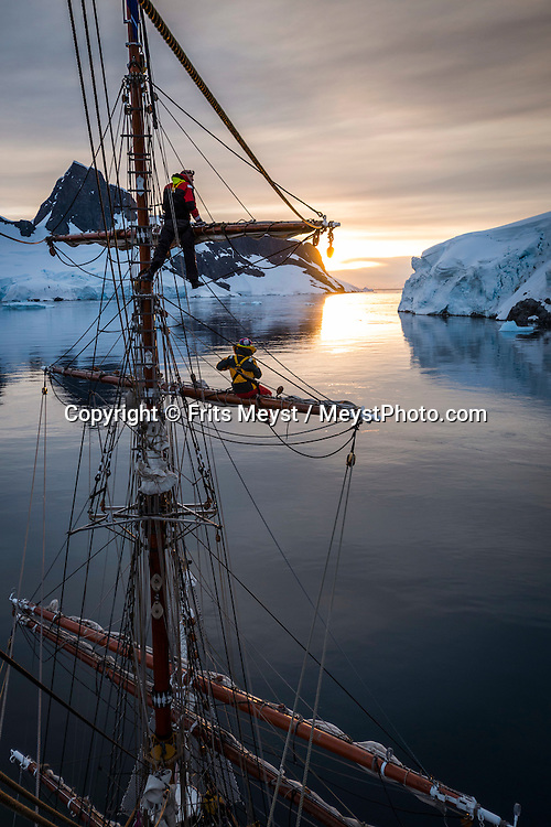 Antarctica, February 2016. Sailing into the sunset through the narrow Graham Passage. A scenic channel that separates Murray Island from the West coast of Graham Land. Captain Skidsmo named it after his whale catcher Graham, which was the first to pass through it, on March 20, 1922.Dutch Tallship, Bark Europa, explores Antarctica during a 25 day sailing expedition. Photo by Frits Meyst / MeystPhoto.com