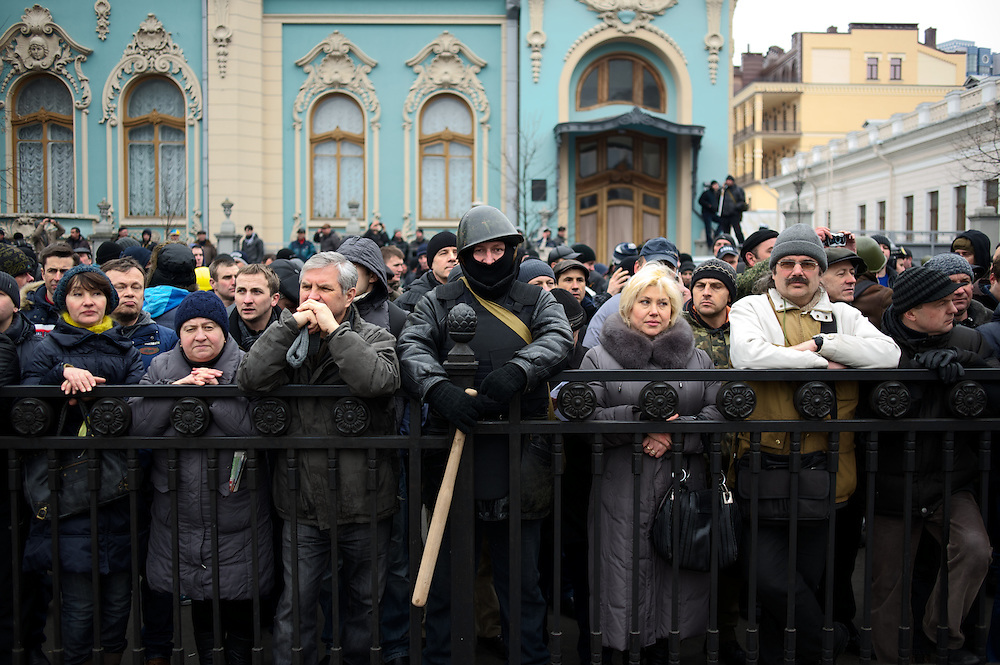 KIEV, UKRAINE - February 22, 2014: People await outside the Ukrainian Parliament building, for the announcement of the formation of the unity government. CREDIT: Paulo Nunes dos Santos