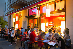 Busy night view of popular Monsieur Vuong Vietnamese restaurant in Mitte Berlin Germany
