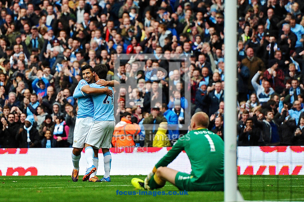 Picture by Ian Wadkins/Focus Images Ltd +44 7877 568959<br /> 02/11/2013<br /> John Ruddy of Norwich City sits dejected after David Silva scores to make it 2-0 during the Barclays Premier League match at the Etihad Stadium, Manchester.