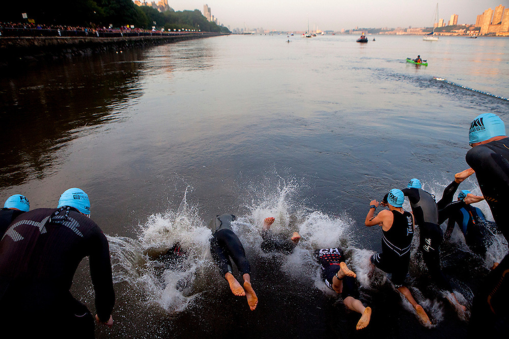 NEW YORK, N.Y. - JULY 19, 2015: Triathletes dive into the Hudson River to begin the 15th Annual Panasonic New York City Triathlon. CREDIT: Sam Hodgson for The New York Times
