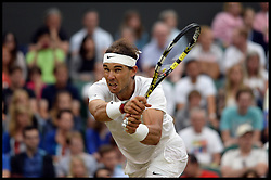 Image ©Licensed to i-Images Picture Agency. 28/06/2014. London, United Kingdom. Rafael Nadal v Mikhail Kukushkin on centre court on Day 6 of the Wimbledon Championship. Nadal went one to win the match. Picture by Andrew Parsons / i-Images