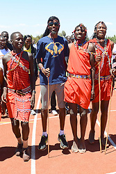 x© London News Pictures. 01/02/2014. Iten, Kenya. VIRGIN MONEY LONDON MARATHON 2014 PREVIEW...Mo Farah, GB (blue t-shirt, sporting a wig) , and Paula Radcliffe open the new London-Marathon-funded running track, which will be managed by the Lornah Kiplagat Sports Academy. They are pictured with a Masai Dancers. (L-R, Radcliffe, Kiplagat, Farah, and Ezekiel Kemboi) Photo credit: Mike King/London Marathon/LNP