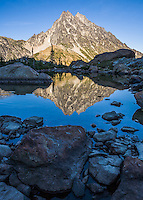 Mount Stuart reflected in still water of Ingalls Lake Central Cascades Washington USA