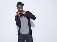 Mid adult (30-35 years) photographer making photo studio shot