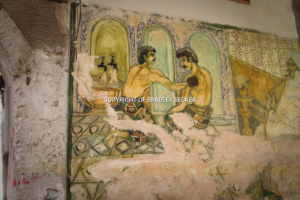 A painting on the wall of a traditional Hammam (bath-house) in the old city of Damascus, showing men scrubbing each other. <br /> <br /> Despite the homo-erotic connotations, this mural is on a wall opposite the grand Ummayed Mosque.