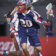 Owen Blye #20 of the Boston Cannons runs with the ball during the game at Harvard Stadium on August 9, 2014 in Boston, Massachusetts. (Photo by Elan Kawesch)