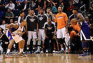 Dec. 17, 2012; Phoenix, AZ, USA; Phoenix Suns bench watches as guard Shannon Brown (26) defends the Sacramento Kings guard Isaiah Thomas (22) in the second half at US Airways Center. The Suns defeated the Kings 101-90.  Mandatory Credit: Jennifer Stewart-USA TODAY Sports