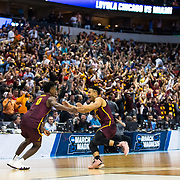 Loyola University Chicago Men's Basketball players celebrate after Donte Ingram hits a game-winning three-pointer in the first round game of the NCAA Tournament against the University of Miami at the American Airlines Center in Dallas, TX., on Thursday, March 15, 2018. (Photo: Lukas Keapproth)