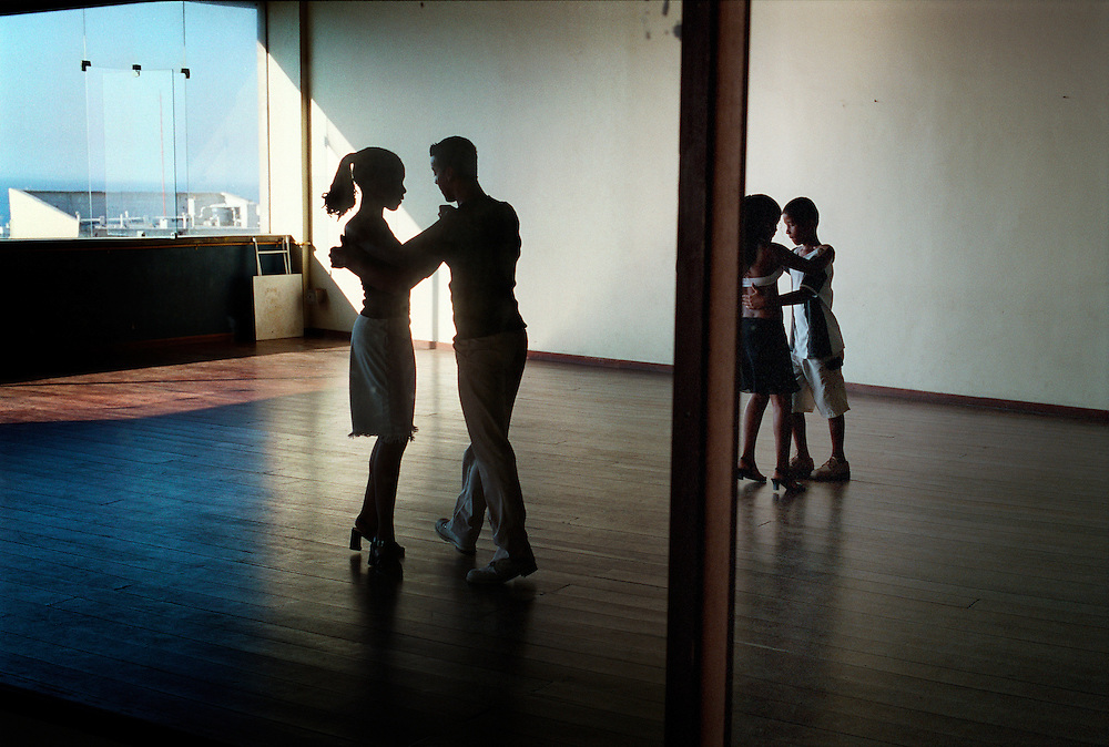 A dance class in a disused building which people from Cantagalo favela use also as an excess point to get to the favela. The favela over looks Ipanema, an exclusive and expensive area in the city. Rio de Janerio, Brazil. 2001