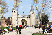 Muslim couple and tourists at the Topkapi Palace, Topkapi Sarayi, part of the Ottoman Empire, in Istanbul, Republic of Turkey