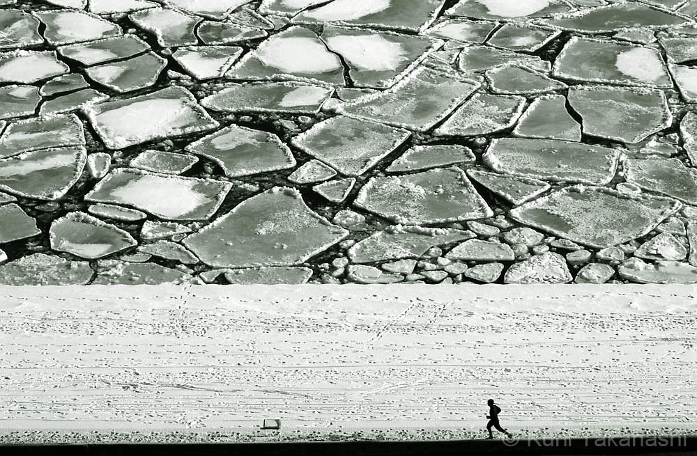 A jogger makes way by Lake Shore Drive in downtown Chicago along the frozen Lake Michigan, Thursday Feb 8, 2007.