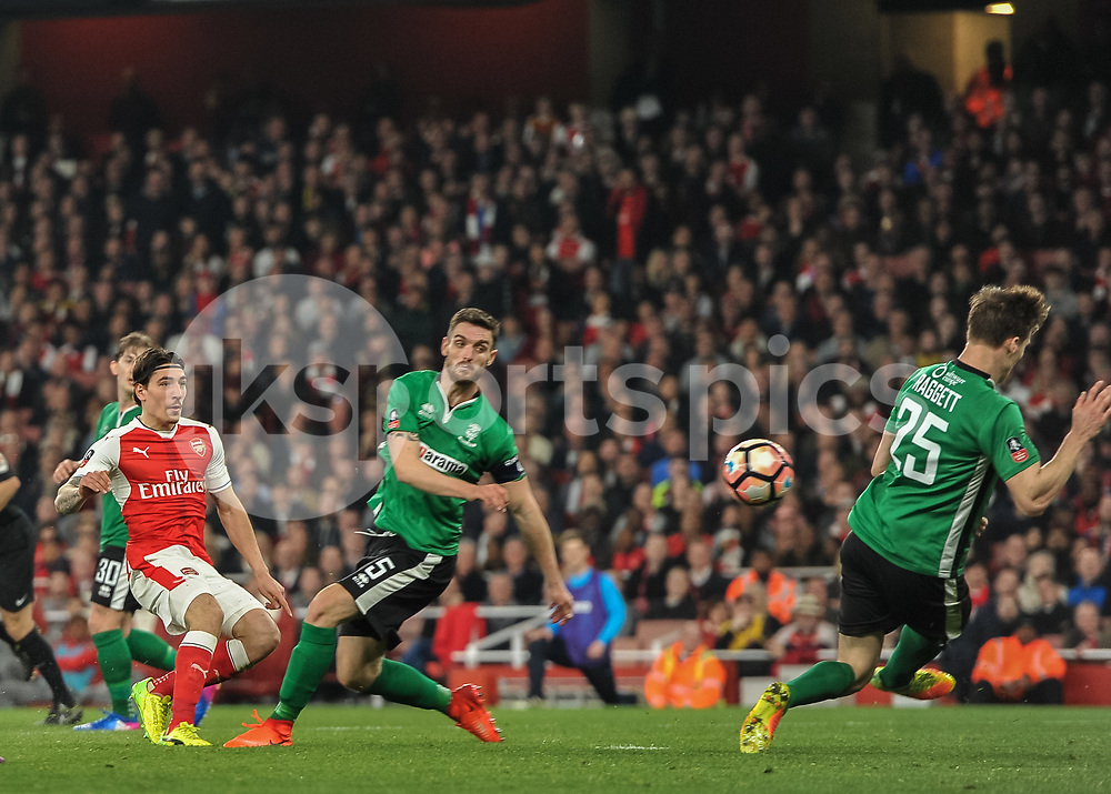 Héctor Bellerín of Arsenal shoots at goal during the The FA Cup sixth round match between Arsenal and Lincoln City at the Emirates Stadium, London, England on 11 March 2017. Photo by Vince Mignott.