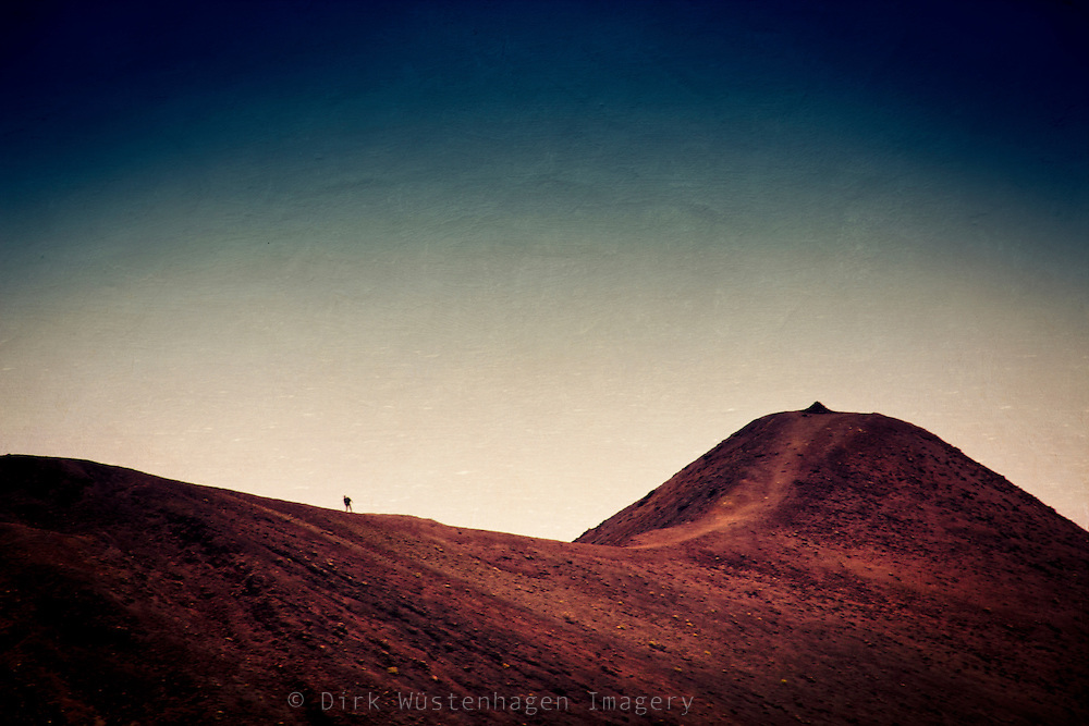 Hiker on a volcanic range in the south of La Palma / Fuencaliente