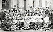 large school group portrait with teachers early 1900s France