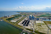 Nederland, Groningen, Eemshaven, 05-08-2014; Haven omzoomd door windmolens. Energie-landschap met elektricitieitscentrales vlinsk de Eemscentrale van Electrabel (stoom- en gascentrale, STEG-centrale - achtergrond). In het midden de RWE-Essent elektriciteitscentrale ( kolencentrale) .<br /> <br /> Harbor area and energy landscape with wind turbines and different power plants: the coal fired  RWE-Essent plant (middle) and the Electrabel STEG  power plant (left).<br /> <br /> luchtfoto (toeslag op standard tarieven);<br /> aerial photo (additional fee required);<br /> copyright foto/photo Siebe Swart