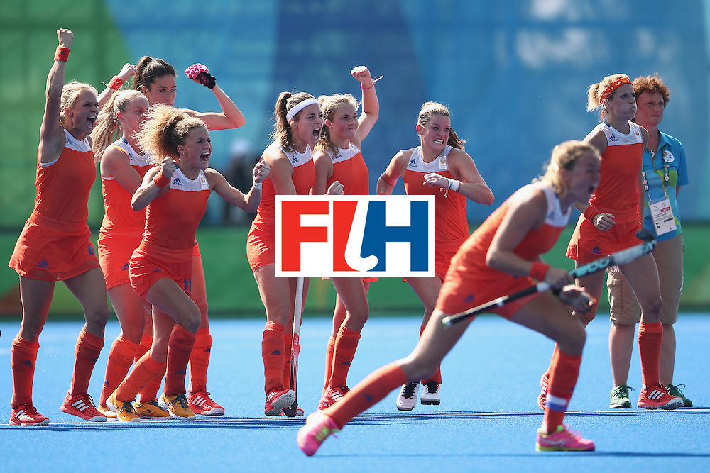 RIO DE JANEIRO, BRAZIL - AUGUST 17:  The Netherlands players celebrate during the penalthy shootout during the womens semifinal match between the Netherlands and Germany on Day 12 of the Rio 2016 Olympic Games at the Olympic Hockey Centre on August 17, 2016 in Rio de Janeiro, Brazil.  (Photo by Mark Kolbe/Getty Images)