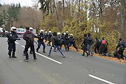Nov. 15, 2015 - Spielfeld, Austria - AUSTRIA, Spielfeld; Changing tactics, as pro-refugee supporters run from police cordons along their route and take to the hills and farmland.  Left wing rally in support of a pro-refugee, no borders policy as it makes its way from Spielfeld railway station up into the surrounding vineyards and mountain villages to encounter an opposing Right wing rally. The group is a loose co-ordination of Antifas and a local district anti-fascist group, comprised mainly of students and many others.  This alpine region lies on the border of the Slovenian town of Sentilj where a vast refugee processing centre has led to raised tensions around the issue.  Credit: Chris Stowers (Credit Image: © Chris Stowers via ZUMA Wire)