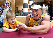 HANOVER, MA.WWE SmackDown! Superstar and West Newbury, MA, homeboy John Cena is bested in an arm-wrestling competitionby 3-year-old  Thomas Long of South Boston during an appearance at the Hanover Mall,beforeCena and the rest of WWE's SmackDown! Superstars displayed their bulk and brawn at the South Shore Music Circus and Cape Cod Melody Tent.