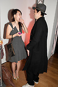 Rinko Kikuchi; Tony Leung, Part of the asian film festival. The afterparty following the UK film premiere of 'Norwegian Wood' at the Haunch Of Venison. London. 3 March 2011 -DO NOT ARCHIVE-© Copyright Photograph by Dafydd Jones. 248 Clapham Rd. London SW9 0PZ. Tel 0207 820 0771. www.dafjones.com.