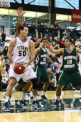 17 December 2011:  Kevin Reed backs in to take a shot at the hoop during an NCAA mens division 3 basketball game between the Washington University Bears and the Illinois Wesleyan Titans in Shirk Center, Bloomington IL