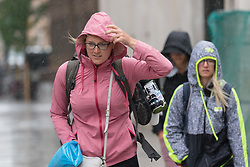 © Licensed to London News Pictures. 29/07/2018. London, UK.  People are caught in a heavy rain shower in central London near London Bridge station this morning.  Photo credit: Vickie Flores/LNP