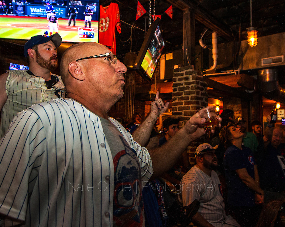 Cubs fans celebrate their team's first World Series victory in 108 years at DT Kirbys in Lafayette, Ind. on Wednesday, November 2, 2016.<br /> <br /> Nate Chute   Photographer