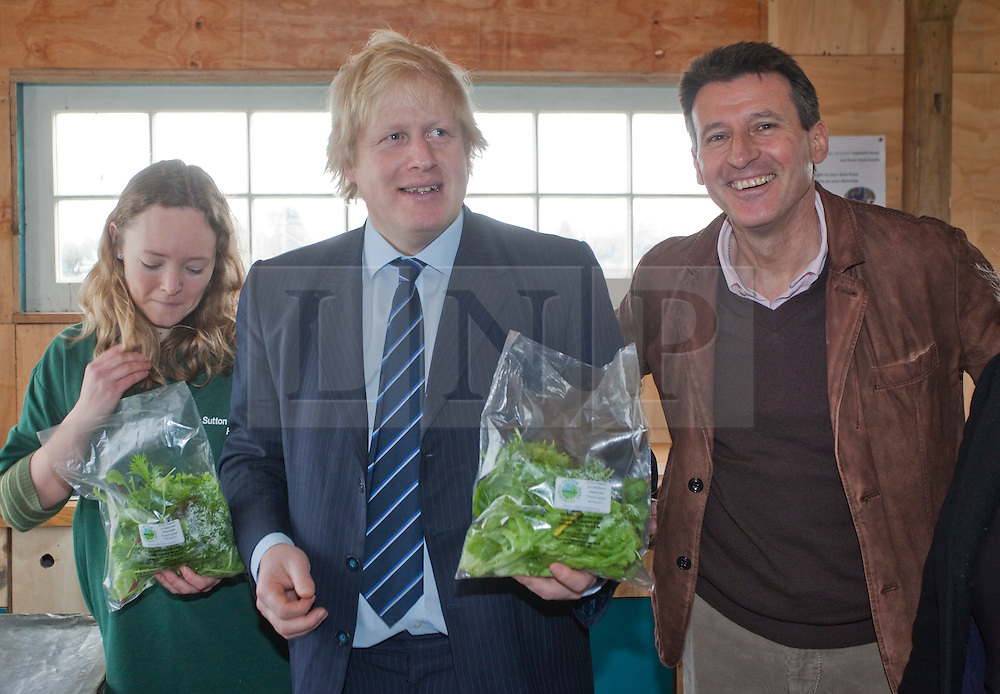 "© Licensed to London News Pictures. 23/02/2012. Wallington, Surrey. L-R: Anna Francis, Farm Manager, Boris Johnson and Seb Coe. The Mayor of London, Boris Johnson and LOCOG Chairman Sebastian Coe today, 23 February 2012, showed off the benefits of urban food growing as they launched ""The Big Dig"" volunteer gardening weekend (16-17 March). This is all in support of Capital Growth, a scheme to create 2,012 community food growing spaces by the end of 2012.  Photo credit: Bettina Strenske/LNP"