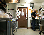 Sal Merlo prepares a sub at Pino's Deli and Cafe in Greece on Friday, March 20, 2015.