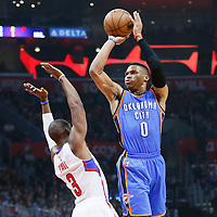 21 December 2015: Oklahoma City Thunder guard Russell Westbrook (0) takes a jump shot over Los Angeles Clippers guard Chris Paul (3) during the Oklahoma City Thunder 100-99 victory over the Los Angeles Clippers, at the Staples Center, Los Angeles, California, USA.