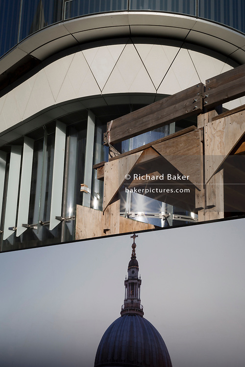A picture of St. Paul's cathedral dome and some construction background of the One Blackfriars residential tower, on 27th October 2017, in Southwark, London, England. 1 Blackfriars or One Blackfriars, is a mixed-use development at the junction of Blackfriars Road and Stamford Street at Bankside, London. The development is a 52-storey 170m tower and two smaller buildings of 6 and 4 stories respectively. Uses include residential flats, a hotel and retail.