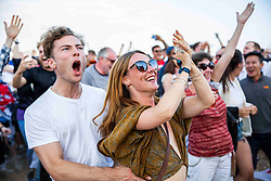 © Licensed to London News Pictures. 11/07/2016. Brighton, UK. Supporters watch the England Vs Croatia World Cup 2018 semi final match on the Beach in Brighton and Hove.  Photo credit: Hugo Michiels/LNP