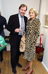 MARK CORNELL and ISABELLA MACPHERSON at an exhibition of artist Jonathan Yeo's portrait paintings held at Eleven, 11 Eccleston Street, London SW1 on 16th February 2006.<br />