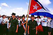 HAVANA, CUBA: Cuban teenagers and military cadets walk along the Malecon in Havana, before an anti-American protest started in front of the American Interests Section, the US unofficial embassy in Havana, Cuba, February 22, 2000. Thousands of Cubans marched in front of the interest section to protest the US unwillingness to return Elian Gonzalez to his father in Cuba.    Photo by Jack Kurtz  CROWDS     HUMAN RIGHTS    YOUTH    EDUCATION      CHILDREN     PATRIOTISM