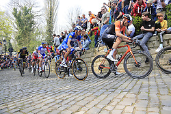 The peloton including Lars Boom (NED) Roompot-Charles and Philippe Gilbert (BEL) Deceuninck-Quick Step on the Muur Kapelmuur Geraardsbergen during the 2019 Ronde Van Vlaanderen 270km from Antwerp to Oudenaarde, Belgium. 7th April 2019.<br /> Picture: Eoin Clarke | Cyclefile<br /> <br /> All photos usage must carry mandatory copyright credit (© Cyclefile | Eoin Clarke)