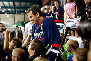 Former Minnesota Gov. Tim Pawlenty, and GOP presidential candidate, emerges from a locker room to play hockey in Des Moines, Iowa, July 22, 2011.