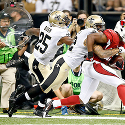 Sep 22, 2013; New Orleans, LA, USA; Arizona Cardinals running back Alfonso Smith (29) is tackled by New Orleans Saints strong safety Kenny Vaccaro (32) during a game at Mercedes-Benz Superdome. The Saints defeated the Cardinals 31-7. Mandatory Credit: Derick E. Hingle-USA TODAY Sports