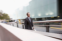 Businessman walking up outdoor ramp