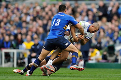 Jonathan Joseph of Bath Rugby takes on the Leinster defence - Photo mandatory by-line: Patrick Khachfe/JMP - Mobile: 07966 386802 04/04/2015 - SPORT - RUGBY UNION - Dublin - Aviva Stadium - Leinster Rugby v Bath Rugby - European Rugby Champions Cup