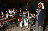Dessie, Ethiopia: With the aid of a whip wielded by their teacher, children learn to read the Koran in Arabic at the Showber Islamic School in Dessie. The pedagogic method is common throughout Africa, and has been used at this madrassa since it opened in the 1930s.  Ethiopia, where political power has historically been associated with the Orthodox Christian church, is now nearly half Muslim. (MIGUEL JUAREZ LUGO).