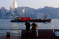 A view of the city skyline and Victoria Harbour from the Promenade in Kowloon, Hong Kong, China.