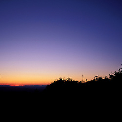 Hiking. Greenleaf Hut, near the Appalachian Trail on Mt. Lafayette. Sunset. Silhouette.  White Mountain N.F., NH