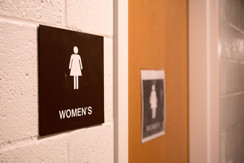 Women's bathroom door is pictured here on Oct. 3, 2017. A student had previously posted a makeshift 'gender neutral' sign, which has been removed now. (Seohyun Shim / The Tufts Daily)