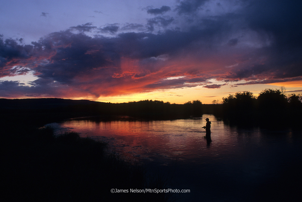08208-B. An angler fly fishes for trout at sunset on the upper Teton River, Idaho.