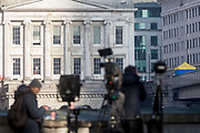 The morning after the terrorist attack at Fishmongers Hall on London Bridge, in which Usman Khan (a convicted, freed terrorist) killed 2 during a knife a attack, then subsequently tackled by passers-by and shot by armed police - news crews film from the Southbank using Fishmongers Hall as a background, on 30th November 2019, in London, England.